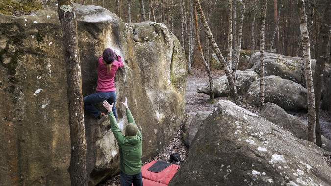 Climbing in Isatis, Fontainebleau (Problem: Red 12)
